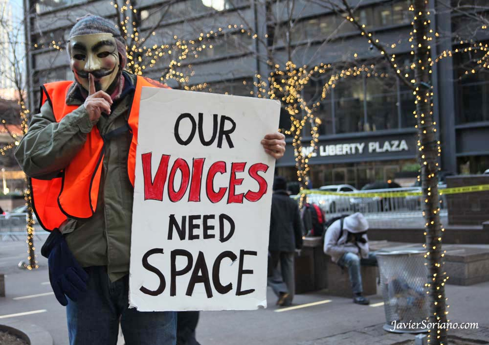 "12/25/2011 - A supporter of Occupy Wall Street (OWS)  holding a sign with the phrase, ""Our voices need space"" at Liberty Square (Zuccotti Park) in NYC. Photo by Javier Soriano/www.JavierSoriano.com"
