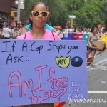 """If a cop stop you, ask: Am I free to go. Know your rights,"" her sign says."