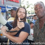 "Monday, August 3, 2015. New York City – Today, a group of people gathered in front of Target in Flatbush, Brooklyn to demand justice for Alando Brissett. On July 25, 2015, Alando Brissett was pinned to the ground and punched by NYPD officers during his arrest at Flatbush Junction Target store. Michael Rolland filmed the arrest and published the video on Youtube. On Youtube, Michael said """"NYPD 70th Precinct cops use overwhelming force to arrest young black man inside Target in Flatbush, Brooklyn, NYC. July 25, 2015, approximately 8:00 PM."" In the video, a group of police officers are shown holding Brissett down on the ground and punching him several times. As soon as the officers began punching the individual, concerned onlookers began crowding around the scene, demanding that the police stop hitting him. ""One person, 50 police,"" one man yells in the video as the number of police officer swells. Photo by Javier Soriano/http://www.JavierSoriano.com/"
