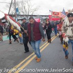 "On Thursday, November 26, 2015, hundreds of Indigenous people and allies gathered at Cole's Hill in Plymouth, Massachusetts to honor Native ancestors. According to the United American Indians of New England, ""it is a day of remembrance and spiritual connection."" The 46th National Day of Mourning was dedicated to Native American political prisoner, Leonard Peltier. Photo by Javier Soriano/http://www.JavierSoriano.com/"