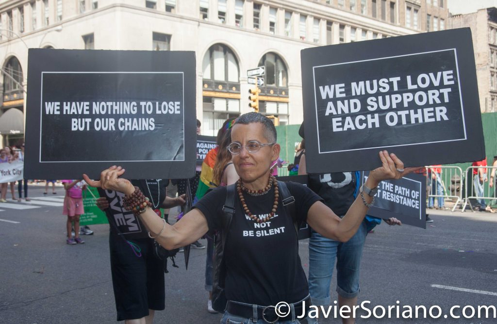 "6/26/2016 LGBTQ PRIDE March. NYC. ""We have nothing to lose but our chains"" ""We must protect and support each other."" Photo by Javier Soriano/www.JavierSoriano.com"