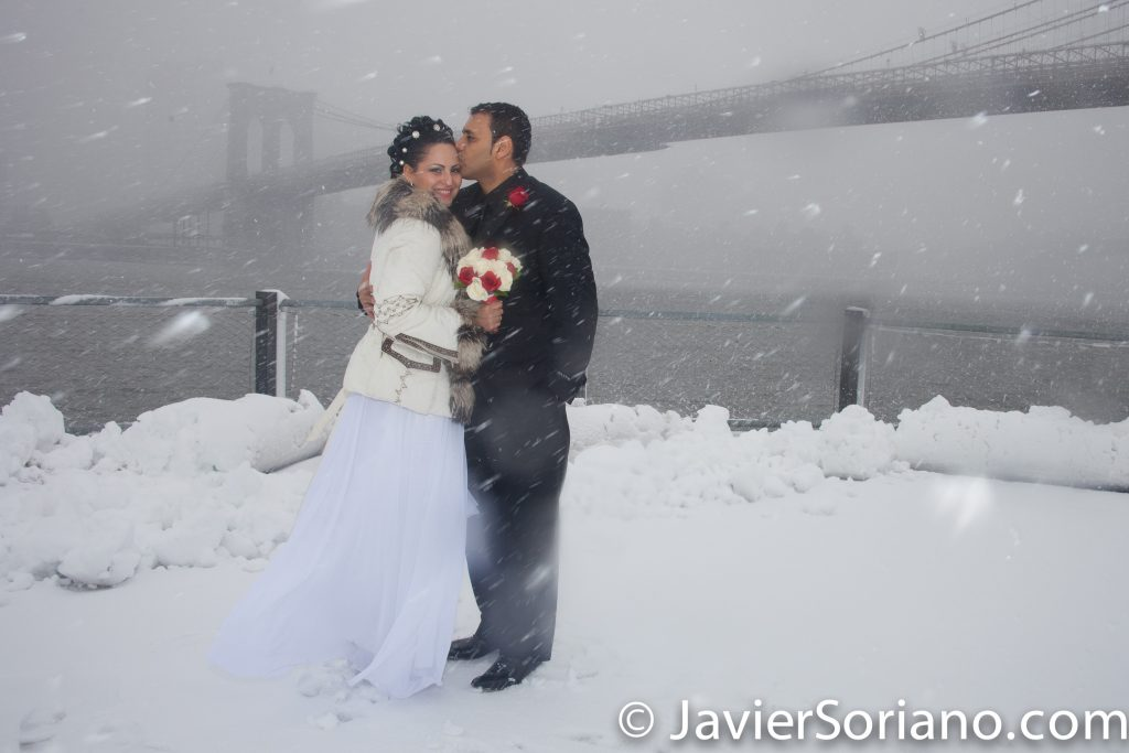 Brooklyn Bridge Park, NYC - It was Winter. It was snowing. We had so much fun creating this wedding photo.  I am a wedding storyteller. I create photographs/videos that you, your children and grandchildren will love for many years.   I love photography/videography. I love weddings. I love couples. I love people!   It will be an honor to create your wedding pictures/videos.  Photo by Javier Soriano/www.JavierSoriano.com