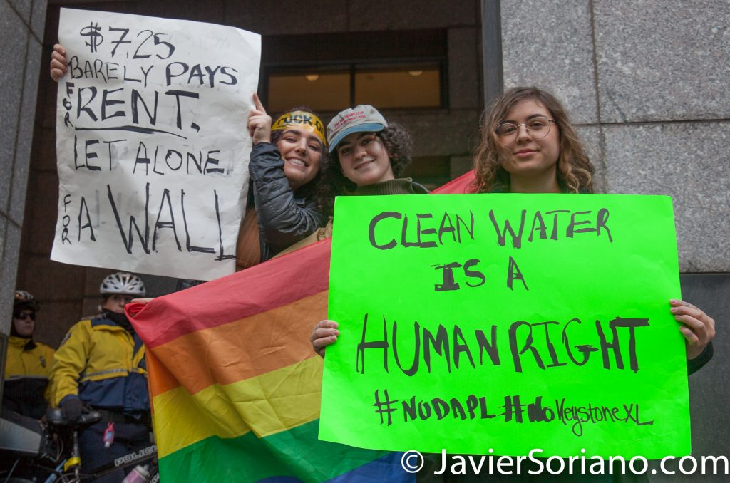 "1/26/2017 People's protectors demonstrate in Philadelphia, PA. People shutted down Goldman Sachs. ""$7.25 barely pays for rent. Let alone for a wall."" ""Clean Water is a human right. #NoDAPL. #NoKeystone XL."" Photo by Javier Soriano/www.JavierSoriano.com"