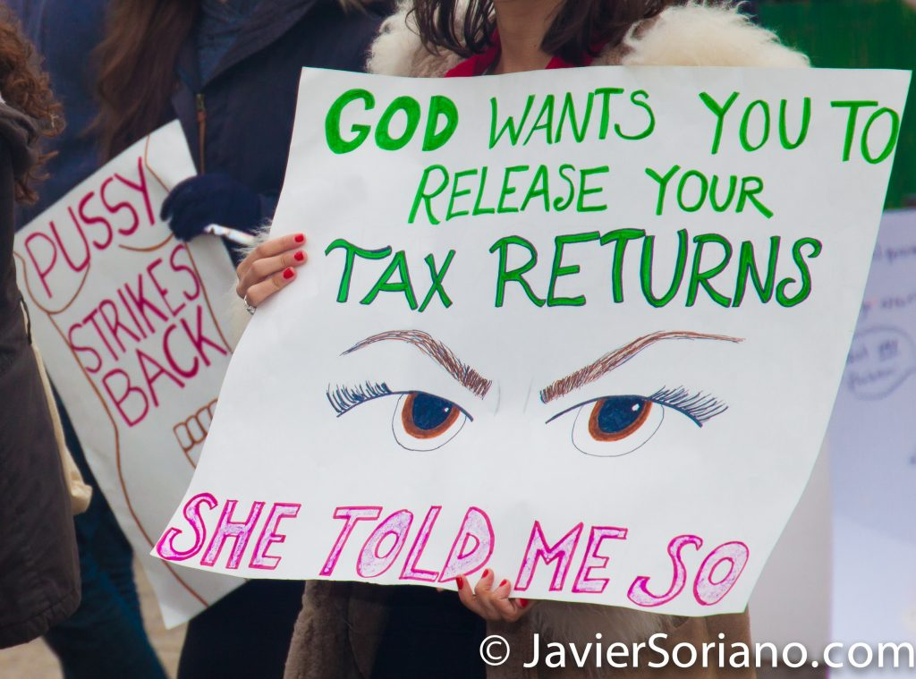 "1/21/2017 - Women's March on Washington D.C.  ""God wants you to release your tax returns. She told me so."" Photo by Javier Soriano/www.JavierSoriano.com"