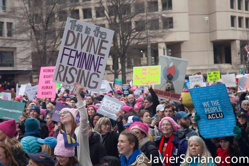 "1/21/2017 - Women's March on Washington D.C.  People in front of the Trump International Hotel. ""This is the divine feminine rising."" ""We the people. ACLU."" Photo by Javier Soriano/www.JavierSoriano.com"