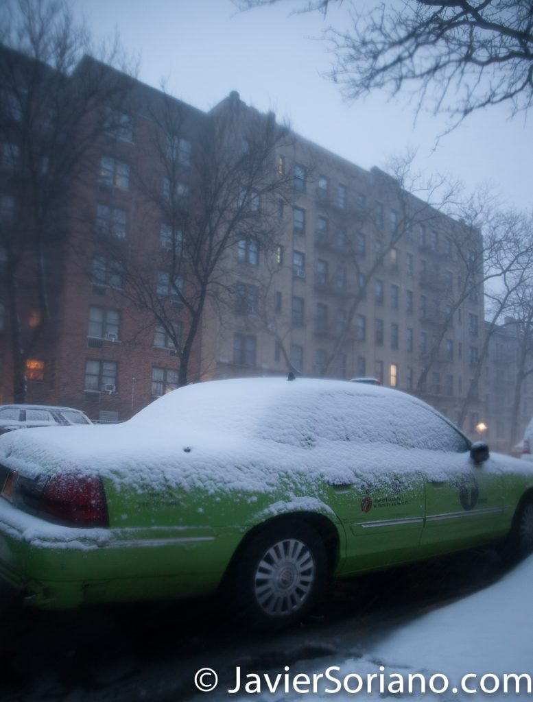 Morning. 2/9/2017 NYC - Winter storm Niko in Brooklyn. A green NYC Taxi covered with snow. Photo by Javier Soriano/www.JavierSoriano.com