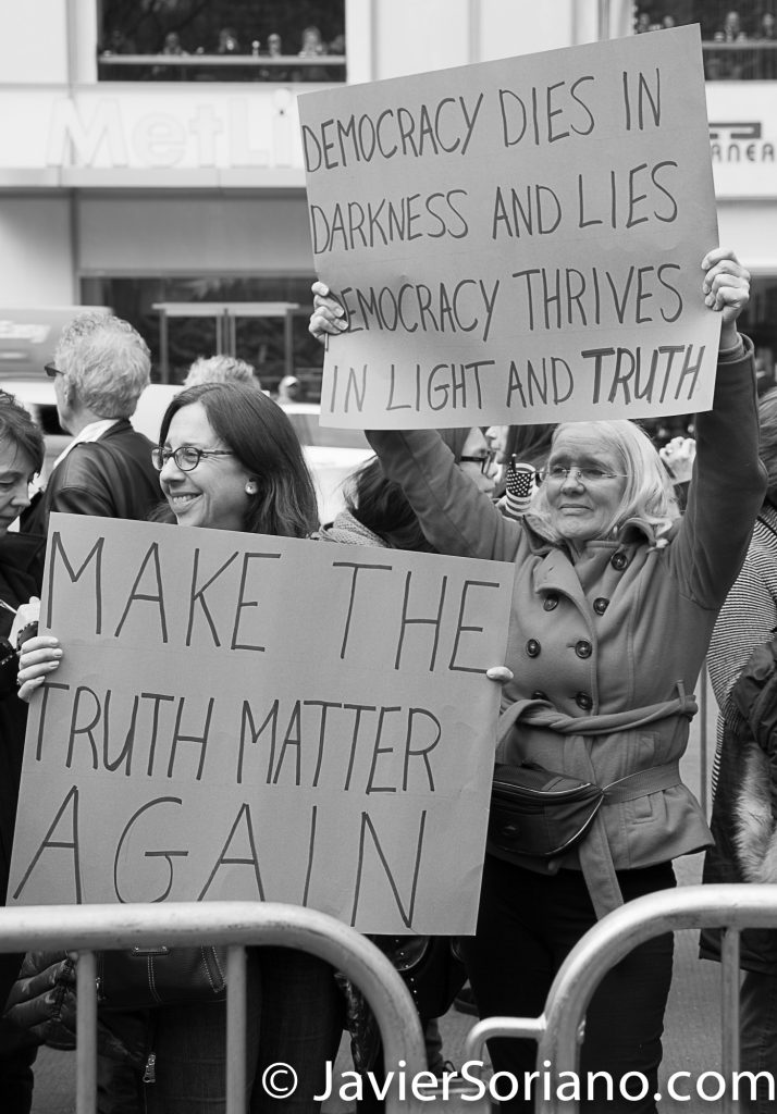 "3/25/2017 NYC - People for Free Press. Activist at Bryant Park. ""Make the truth matter again."" ""Democracy dies in darkness and lies. Democracy thrives in light and truth."" Photo by Javier Soriano/www.JavierSoriano.com"