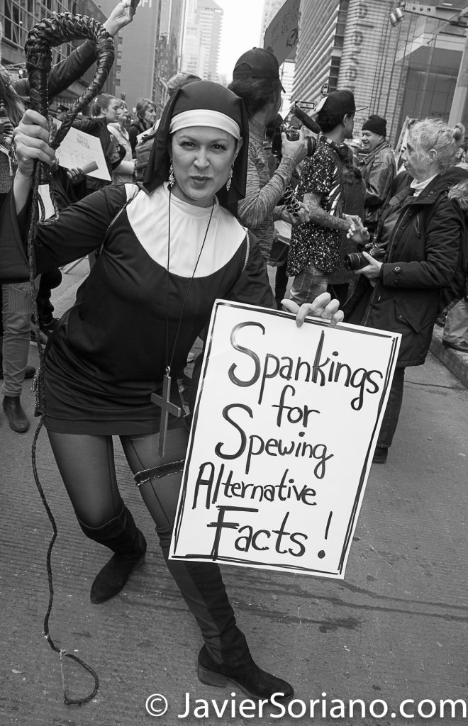 "3/25/2017 NYC - People for Free Press. Activists in front of the New York Times building. ""Spankings for spewing alternative facts!"" Photo by Javier Soriano/www.JavierSoriano.com"