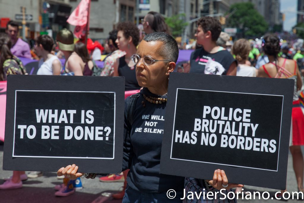 "6/25/2017 Manhattan, NYC - Pride March 2017. ""What is to be done?"" ""Police brutality has no borders."" Photo by Javier Soriano/www.JavierSoriano.com"
