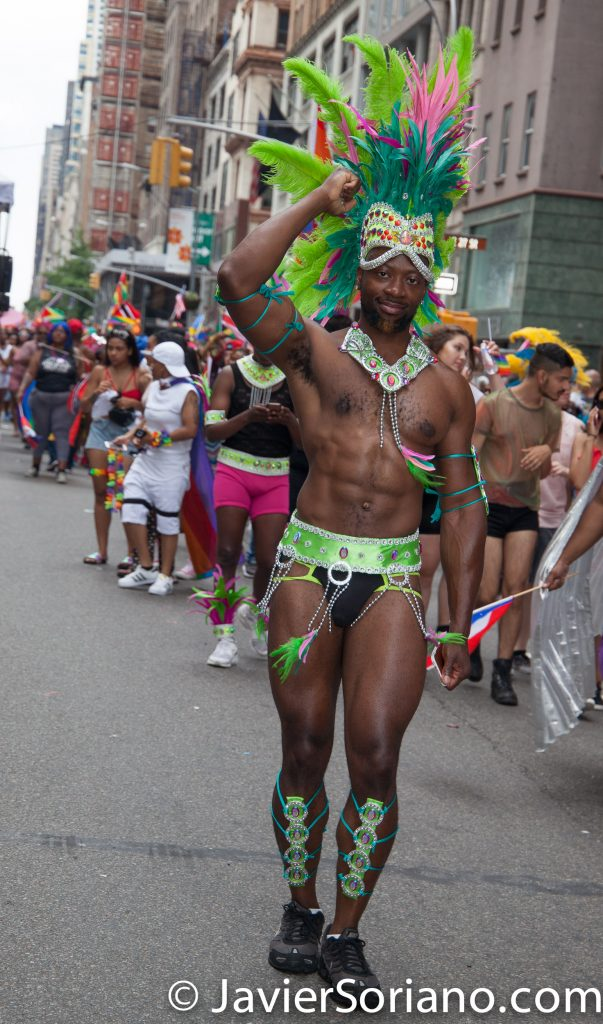 6/25/2017 Manhattan, NYC - Pride March 2017. A handsome Caribbean man marching in the LGBTQ march. Photo by Javier Soriano/www.JavierSoriano.com