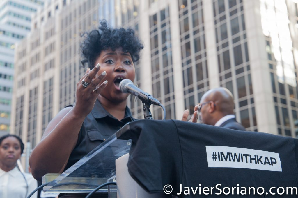 "8/23/2017 NYC - Woman singing ""Lift Every Voice and Sing,"" known as the Black National Anthem at the ""United We Stand"" rally in support of Colin Kaepernick.  James Weldon Johnson composed the lyrics of ""Lift Ev'ry Voice and Sing."" Photo by Javier Soriano/www.JavierSoriano.com"