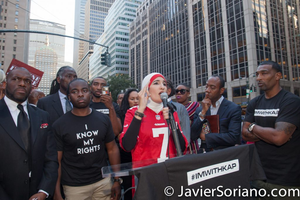 "8/23/2017 NYC -  Linda Sarsour was one of the speakers at the ""United We Stand"" rally in support of Colin Kaepernick. Left side: NYPD Sergeant Edwin Raymond and retired NYPD detective Graham Weatherspoon. Linda is a Palestinian-American-Muslim, civil rights activist, National Co-Chair of Women's March, co-founder MPower Change.   Photo by Javier Soriano/www.JavierSoriano.com"