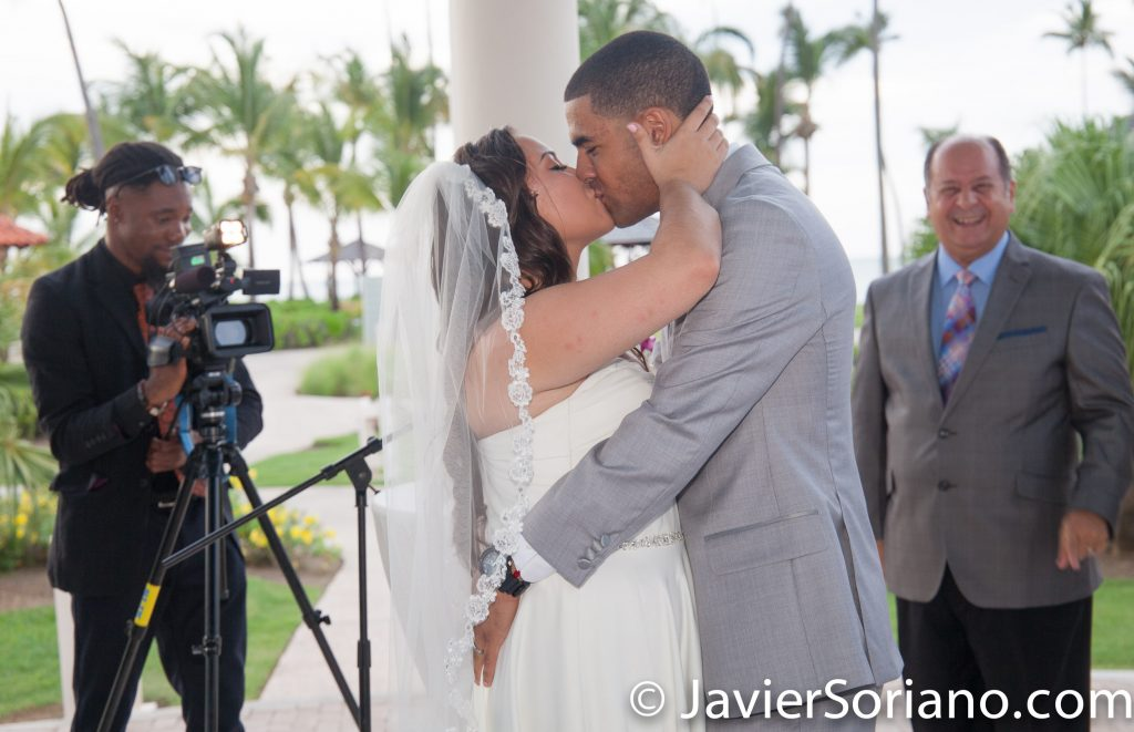 9/15/2017. Melia Coco Beach Resort. Rio Grande. Puerto Rico.  First kiss of the newly-wed couple.   Are you having your wedding in NYC, Puerto Rico, Trinidad & Tobago, Mexico, etc.? I can be your photographer or videographer. I live in New York City. I can travel.  Photo by Javier Soriano/www.JavierSoriano.com