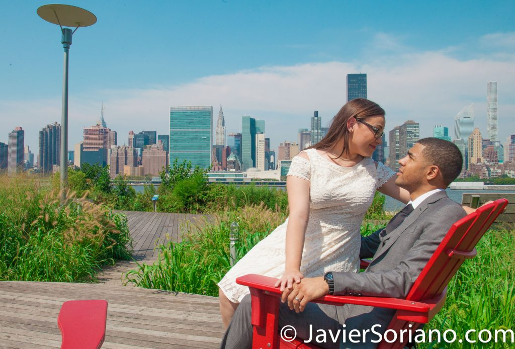 9/5/2017. Long Island City. Queens, New York City - Couple celebrating their civil marriage. United Nations building, Chrysler Building, Empire State Building and other skyscrapers in midtown Manhattan in the background. Photo by Javier Soriano/www.JavierSoriano.com
