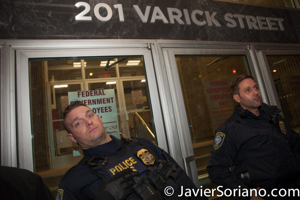 """1/11/2018 201 Verick Street. Immigration detention center. Manhattan, New York City - Vigil in support of Ravi Ragbir. Agents blocking the entrance of the building. """"On January 11, 2018, Ravi Ragbir, a nationally recognized immigrant rights leader and Executive Director of the New Sanctuary Coalition of New York City, was detained while reporting to U.S. Immigration and Customs Enforcement (ICE) for a routine check-in.""""_Ravi defense team Photo by Javier Soriano/www.JavierSoriano.com"""
