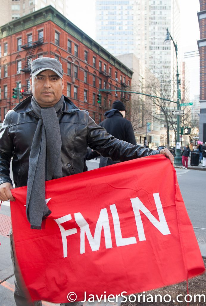 1/20/2018. Manhattan, NYC - Women's March. A man with the FMLN flag.  Photo by Javier Soriano/www.JavierSoriano.com