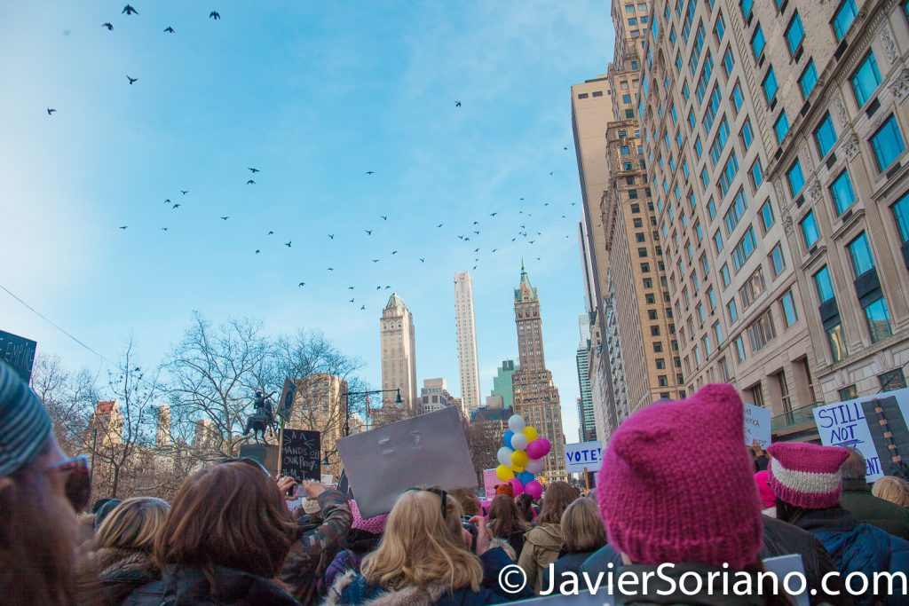1/20/2018. Manhattan, NYC - Women's March. Marching from Central Park West to Times Square. Pigeons flying.  Photo by Javier Soriano/www.JavierSoriano.com