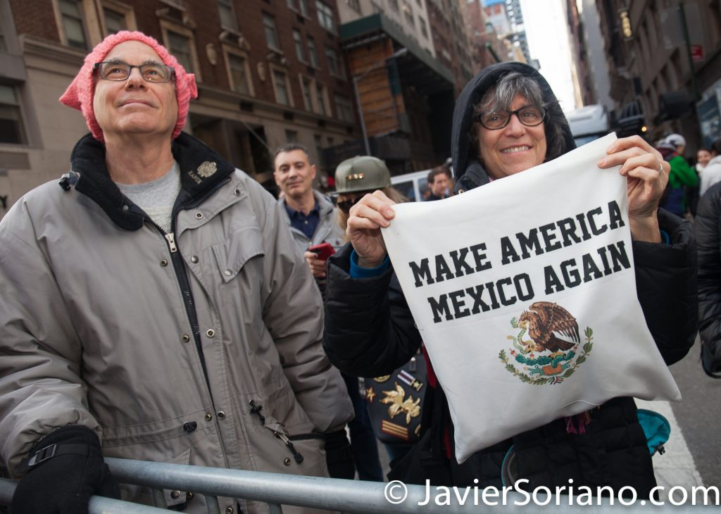 "1/20/2018. Manhattan, NYC - Women's March. People watching the march. ""Make America Mexico Again"" Photo by Javier Soriano/www.JavierSoriano.com"