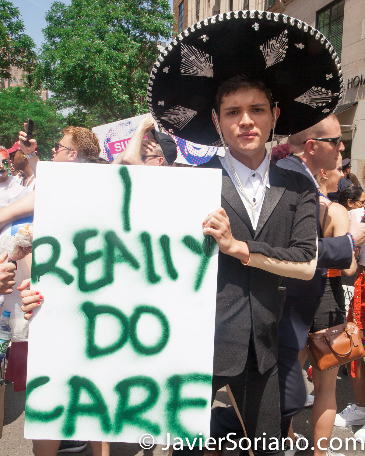 "6/24/2018. New York City - The NYC Pride March celebrated 49 years.  Melania Trump said: ""I really don't care. Do you?"" This young man says: ""I really do care.""  Photo by Javier Soriano/www.JavierSoriano.com"