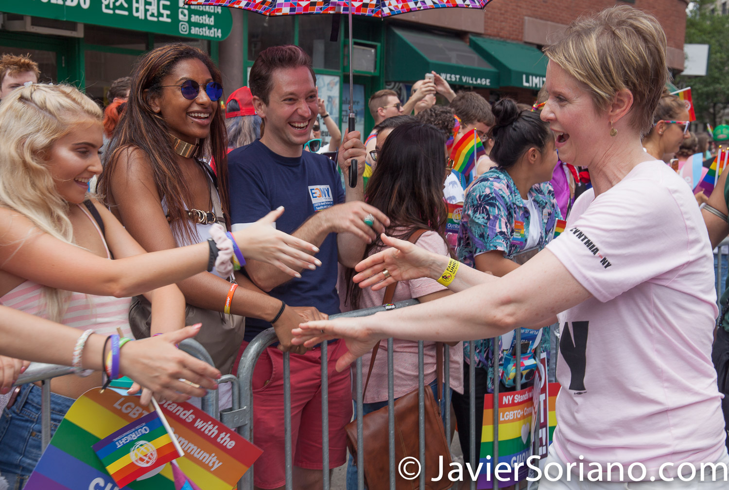 "6/24/2018. New York City - The NYC Pride March celebrated 49 years.  Cynthia Nixon and people watching the March. People were very happy to see her.   Cynthia is a ""Lifelong New Yorker, actor, and progressive advocate running for governor to fight for a better, more fair New York.""  Photo by Javier Soriano/www.JavierSoriano.com"