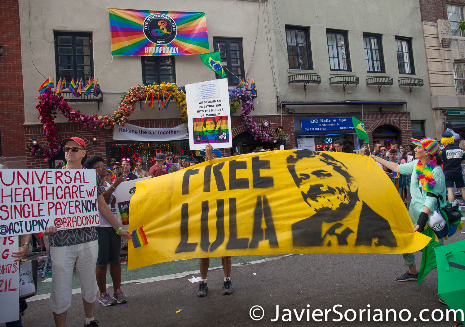 "6/24/2018. New York City - The NYC Pride March celebrated 49 years.  People in front of the Stonewall Inn Bar in Manhattan. The banner says: ""Free Lula""  Photo by Javier Soriano/www.JavierSoriano.com"