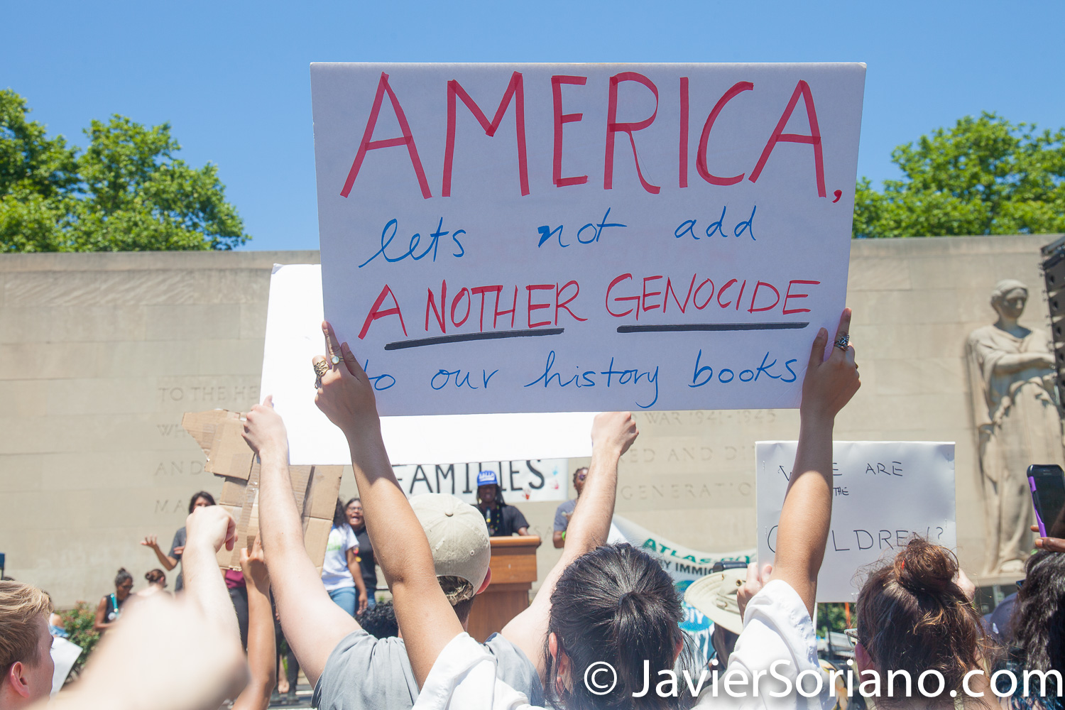 "6/30/2018. March: ""Families Belong Together."" People at Cadman Plaza. People's protectors marched from Foley Square in Manhattan to Cadman Plaza in Brooklyn. The sign says: ""AMERICA, let's not add ANOTHER GENOCIDE to our history books."" Photo by Javier Soriano/www.JavierSoriano.com"