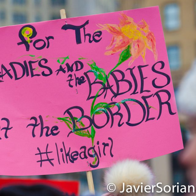 """Foley Square, Manhattan. New York City. The third annual Women's March was on Saturday, January 19, 2019. Hundreds of people attended the rally at Foley Square Park in suppport of women's rights. The sign says: """"For the ladies and the babies at the border. #LikeAGirl"""" (""""Para las damas y l@s bebés en la frontera"""") Photo by Javier Soriano/JavierSoriano.com"""