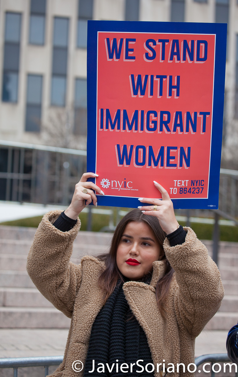 "Foley Square, Manhattan. New York City. The third annual Women's March was on Saturday, January 19, 2019. Hundreds of people attended the rally at Foley Square Park in suppport of women's rights. A young woman with a sign that reads: ""We stand with immigrant women."" Photo by Javier Soriano/JavierSoriano.com"