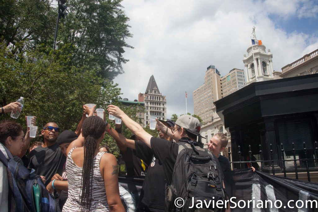 Tuesday, August 2nd, 2016 New York City – Mayor Bill de Blasio and Commissioner William J. Bratton announced that Bratton was going to step down as NYPD Commissioner in September, 2016. Chief James P. O'Neill would be the next NYPD Commissioner. Black Lives Matter activists celebrate in front of City Hall. Photo by Javier Soriano/http://www.JavierSoriano.com/