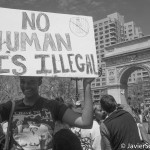 """No human is illegal"" A protester in Washington Square Park. She marched to Union Square Park. Photo taken by Javier Soriano/www.JavierSoriano.com on 5/1/2014"