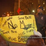 """12/19/2014 City Hall, NYC - Protestors against police brutality trying to cross the Brooklyn Bridge. The sign says, """"Eric Garner, Akai Gurley, Tamir Rice, Sean Bell, Trayvon Martin, Mike Brown. NO MORE!"""" Photo by Javier Soriano/www.JavierSoriano.com"""