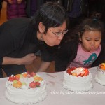 1/23/2015 NYC - Fay Chiang and a child blowing the candles of her birthday cakes.   Photo by Javier Soriano/www.JavierSoriano.com