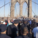 55/14/2015 - March across the Brooklyn Bridge. People demand stronger rent laws and affordable housing for New Yorkers. (These are NYPD police officers.) Photo by Javier Soriano/http://www.JavierSoriano.com/