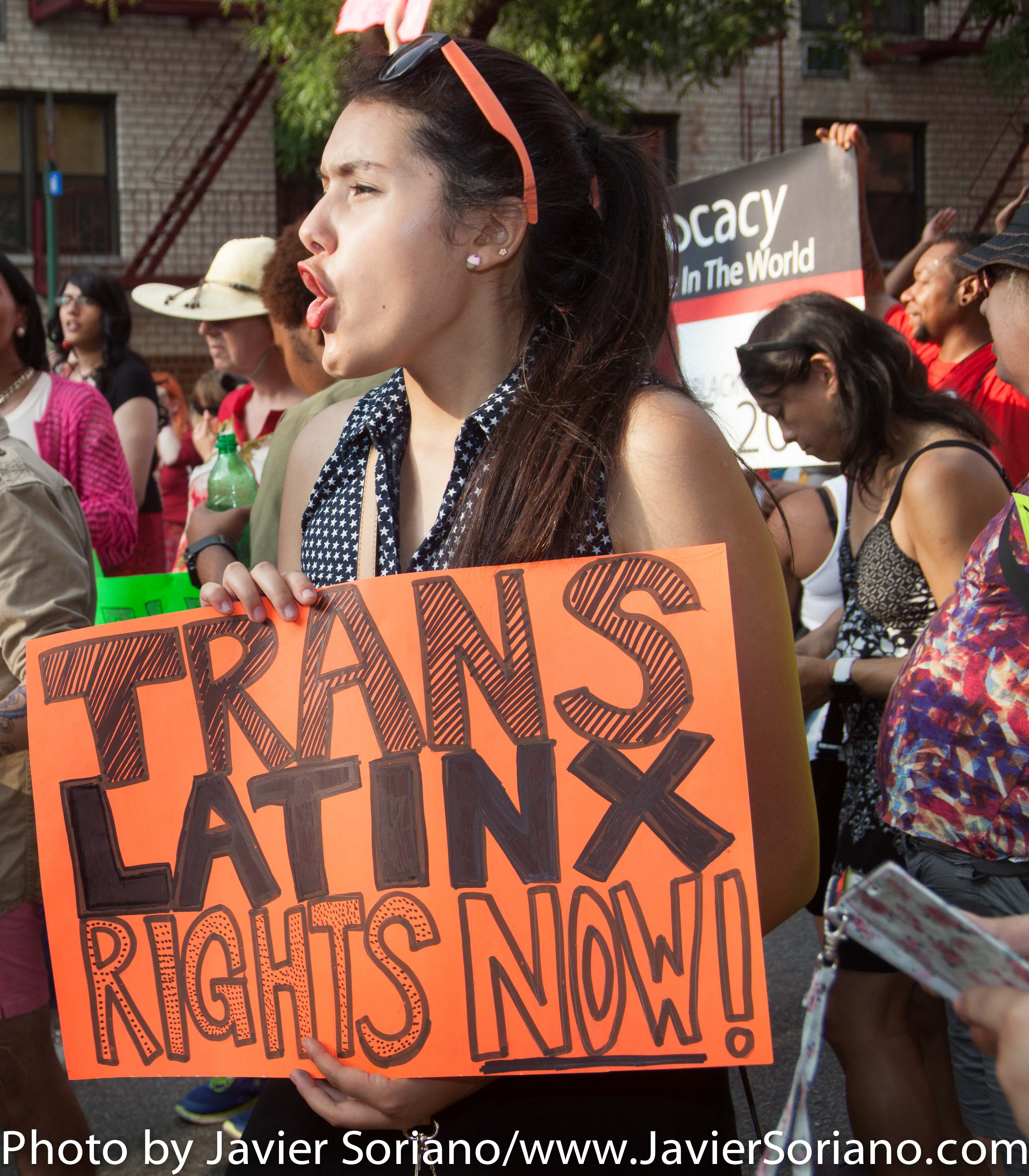 """On Friday, June 26, 2015, was the 11th Annual Trans Day of Action. TransJustice of the Audre Lorde Project, created by and for Trans and Gender Non-Conforming People of Color, gathered Trans and Gender Non-Conforming organizations and allies to march and rally on the Christopher Street Pier/Pier 45 for the 11th Annual Trans Day of Action. """"Visibility is important, and we've won many victories in the past year, but we know we still have a lot of work to do to end oppression and violence against Trans and Gender Non Conforming People of Color,"""" said Elliott Fukui, TransJustice Program Coordinator at the Audre Lorde Project. """"We need to continue organizing to find solutions to get our people safe housing, comprehensive healthcare, an end to police profiling, meaningful living wage employment, and safety in our streets from all forms of violence."""" Photo by Javier Soriano/http://www.JavierSoriano.com/"""