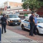 7/6/2015 Brooklyn, NYC - NYPD officers observing #PeoplesMonday activists.   Photo by Javier Soriano/http://www.JavierSoriano.com/