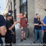 7/6/2015 Brooklyn, NYC - A community affairs NYPD officer talks with #PeoplesMonday activists in Flatbush. Photo by Javier Soriano/http://www.JavierSoriano.com/