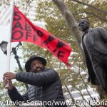"""10/24/2015 NYC - Rally in support of people killed by police in the United States of America. (in the back, the monument depicts Benito Juárez (1806–1872), one of Mexico's most loved political figures and the first Mexican figure to be commemorated with a city monument. Mexican sculptor Moises Cabrera Orozco (b. 1936) created the piece, which portrays Juárez leaning on a tablet with his quotation, """"Respect for the rights of others is peace,"""" inscribed in both Spanish and English.)  Photo by Javier Soriano/http://www.JavierSoriano.com/"""
