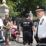 8/2/2016 - NYPD agent and #ShutDownCityHallNYC demonstrators in Abolition Park ( City Hall Park). NYC. Photo by Javier Soriano/http://www.JavierSoriano.com/