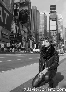 """Times Square. New York City. Young man visiting """"The City that Never Sleeps."""" Photo by Javier Soriano/www.JavierSoriano.com"""