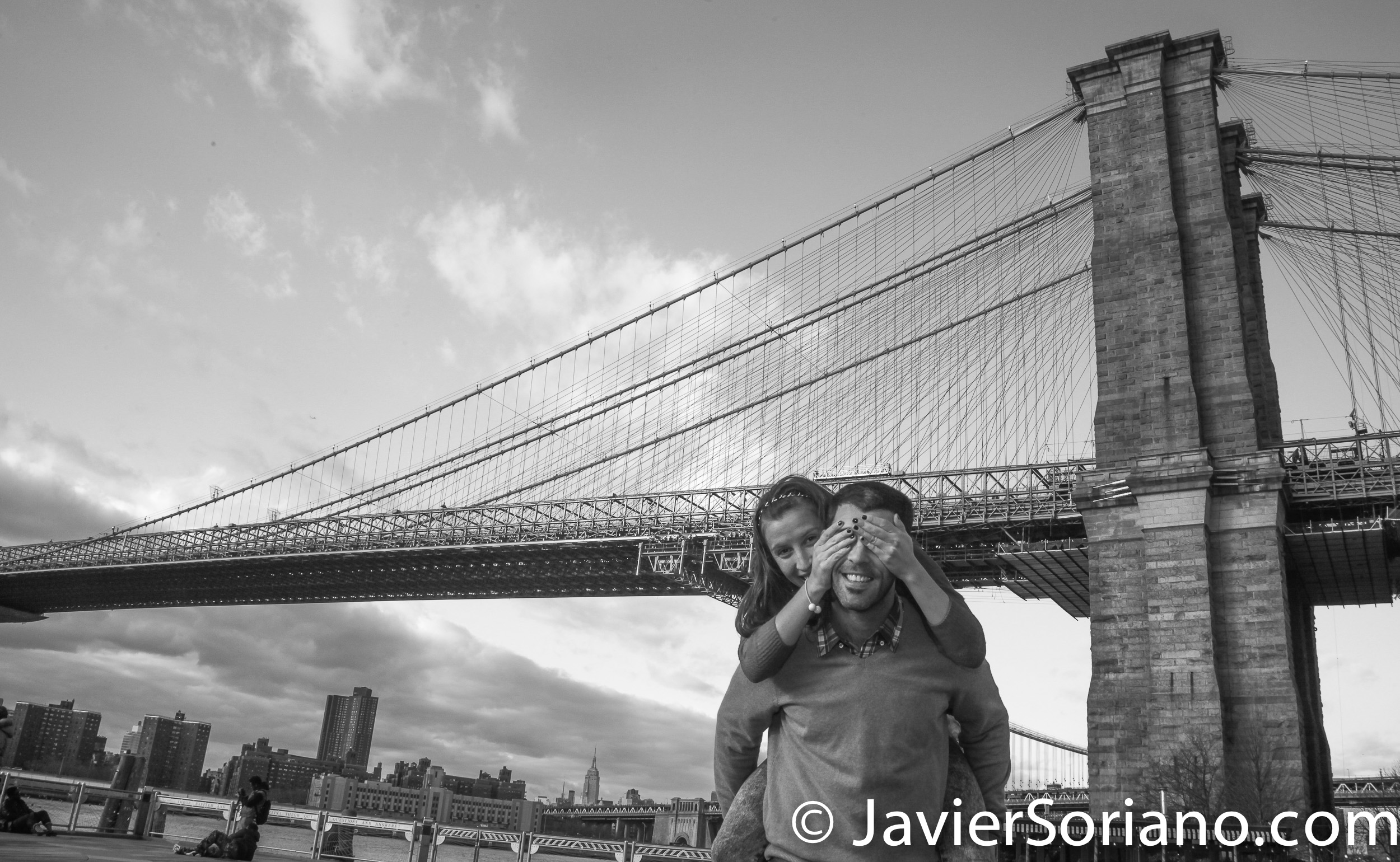 """Couple visiting NYC. The Brooklyn Bridge on the background. I can be your personal photographer/videographer in New York City. With a tour of """"The City That Never Sleeps"""" with a professional and personal photographer/videographer, you will visit the most interesting places of """"The Capital of the World"""" and you will save time and money. I know New York City, I love photography/videography, I love people, I love traveling and I love tourists. I love what I do! Send me a message. Photo by Javier Soriano/www.JavierSoriano.com"""
