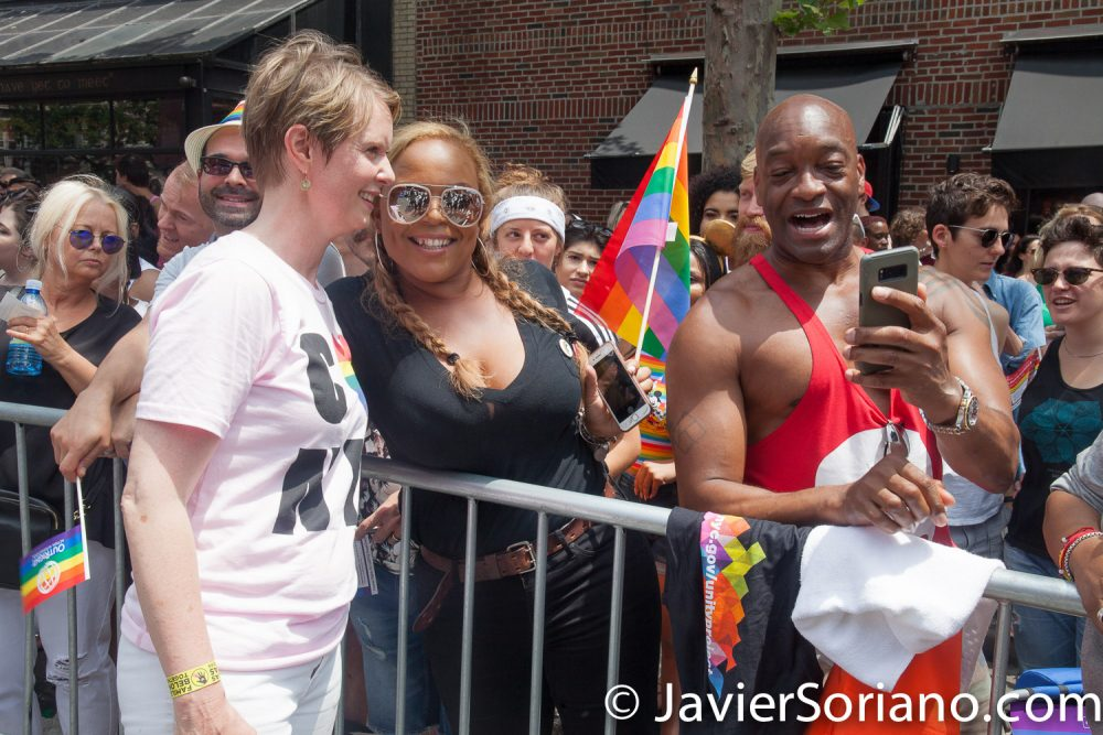 """6/24/2018. New York City - The NYC Pride March celebrated 49 years. Cynthia Nixon and people watching the March. People were very happy to see her. Cynthia is a """"Lifelong New Yorker, actor, and progressive advocate running for governor to fight for a better, more fair New York."""" Photo by Javier Soriano/www.JavierSoriano.com"""