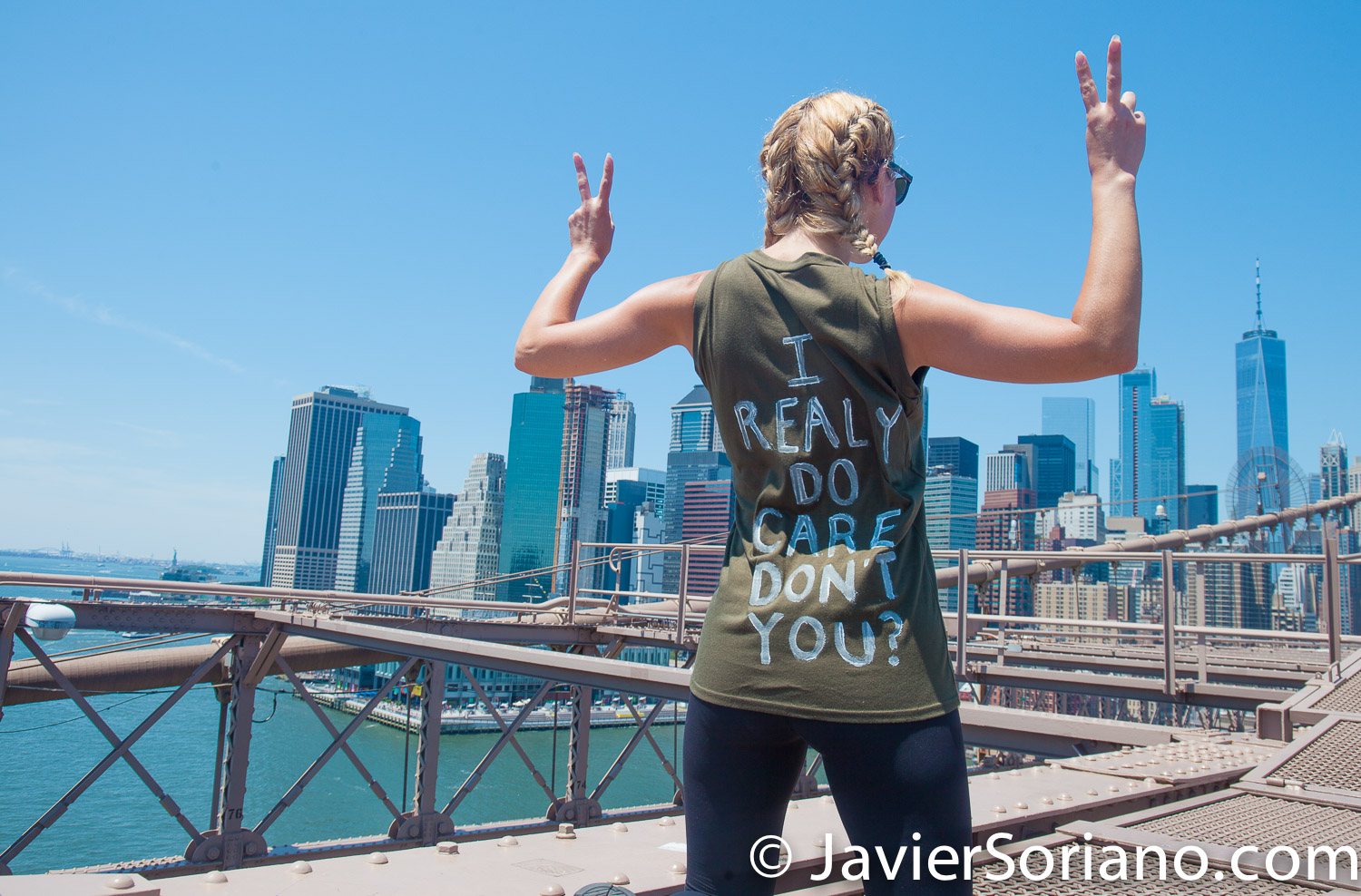 """6/30/2018. March: """"Families Belong Together."""" People crossing the Brooklyn Bridge. People's protectors are marching from Foley Square in Manhattan to Cadman Plaza in Brooklyn. The t-shirt says: """"I really do care. Don't you?"""" The jacket of Melania Trump said: """"I really don't care. Do you?"""" Photo by Javier Soriano/www.JavierSoriano.com"""