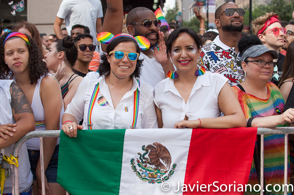Sunday, June 30th, 2019. New York City – Mexican women with the Mexican flag at the NYC Pride March. The 50th anniversary of the Stonewall Rebellion was on Friday, June 28th, 2019. People from around the world came to New York City to celebrate.