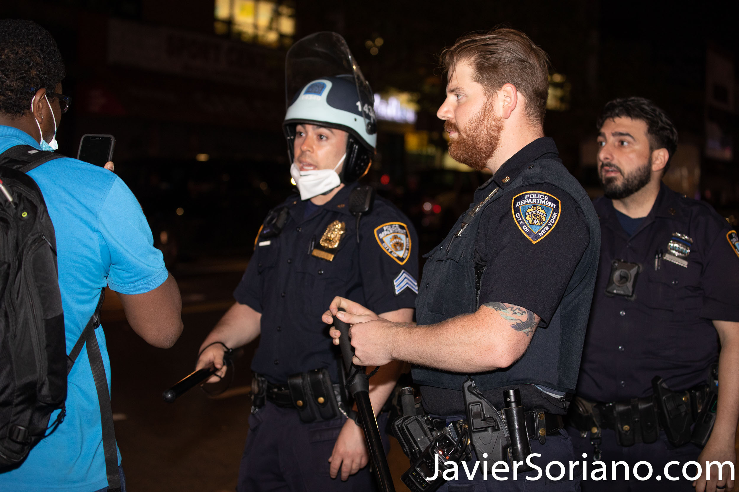 Sunday, May 31, 2020 (12:30 AM) Brooklyn, New York City - NYPD officers harassing a resident of Flatbush. The Black man is not a demonstrator, he just want to get to his home.  The NYPD officers in the photo are not wearing a mask. New York governor, Andrew Cuomo and NYC Mayor, Bill de Blasio say, we need to wear a mask (it can be a home made mask). According to data from Johns Hopkins University, until today, 5/31/2020, more than 30,000 people have died of COVID-19 in New York state.   Photo by Javier Soriano/www.JavierSoriano.com