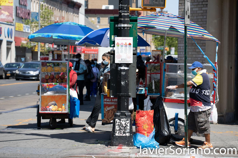 Thursday, May 21, 2020. Brooklyn, New York City - Ecuadorians selling scrapings, churros and empanadas. Jueves 21 de mayo de 2020. Brooklyn, ciudad de Nueva York - Señora ecuatoriana y Señor. ecuatoriano vendiendo raspados, churros y empanadas. Photo by Javier Soriano/www.JavierSoriano.com