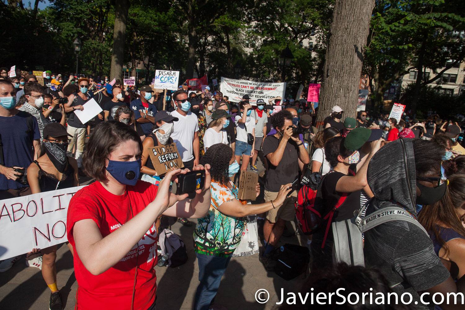 """Monday, June 29, 2020. New York City – """"Mass March to Defund the NYPD and Abolish the Police"""" organized by NYC-DSA. People gathered in Washington Square Park in Manhattan and marched to City Hall Park to join people at """"Occupy City Hall"""". Protesters """"demand that the City Council cut the NYPD police force and the NYPD budget in half and re-invest in community and social needs."""" Photo by Javier Soriano/www.JavierSoriano.com"""