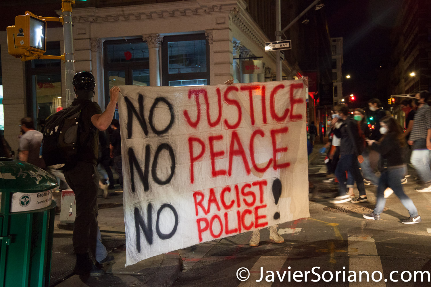 """Sunday, May 31, 2020. New York City - March from Barclays Center, Brooklyn to Manhattan to demand justice for George Floyd, to support Black Lives Matter and to demand police accountability. Protesters from Brooklyn walked across the Manhattan Bridge in a fourth day of consecutive protests in """"The Capital of the World."""" The sign says, """"NO JUSTICE, NO PEACE. NO RACIST POLICE!"""". Photo by Javier Soriano/www.JavierSoriano.com"""