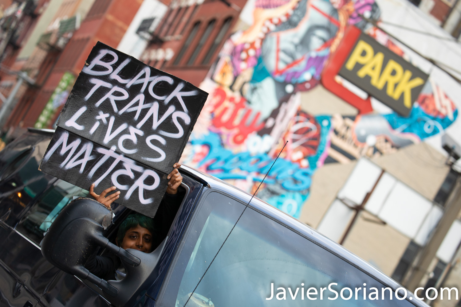 """Tuesday, June 2, 2020. New York City - March from The Stonewall Inn to the Lower Manhattan to demand justice for George Floyd, Breonna Taylor, and too many others victims of police violence in the United States of America. A person observing the march. The sign says, """"Black Trans Lives Matter"""". Photo by Javier Soriano/www.JavierSoriano.com"""