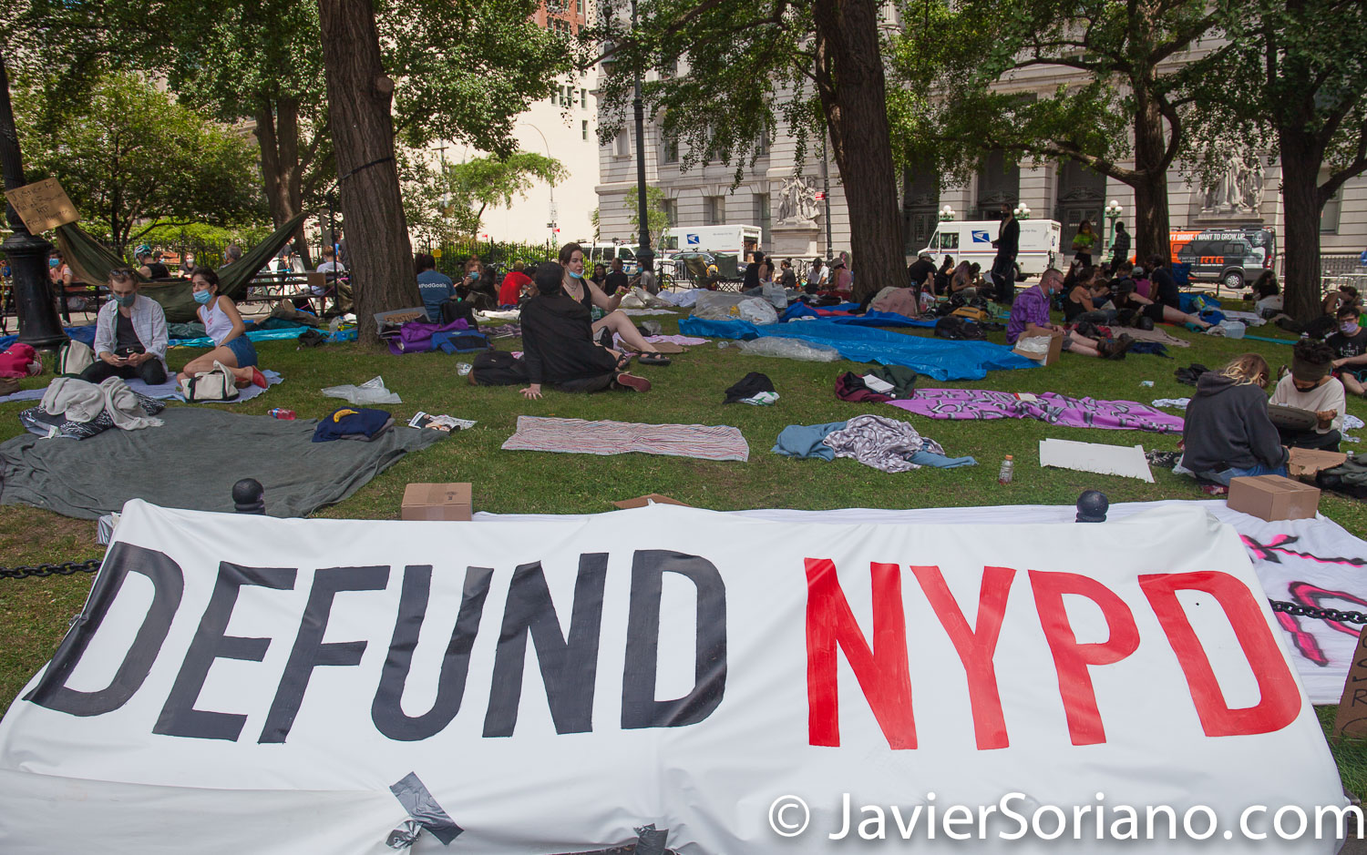 "Wednesday, June 24, 2020. New York City – On Tuesday, June 23, 2020, more than hundred people along with VOCAL-New York and New York Communities for Change started to ""Occupy City Hall"" in New York City. They demand NYC Council members and NYC Mayor Bill de Blasio Defund The NYPD by at least $1 billion and invest in Youth services, affordable housing, healthcare, public education, social workers, and other social services in low income communities. Activists say they are not leaving City Hall Park until at least $1 billion is cut from the NYPD's $6 billion budget. Photo by Javier Soriano/www.JavierSoriano.com"