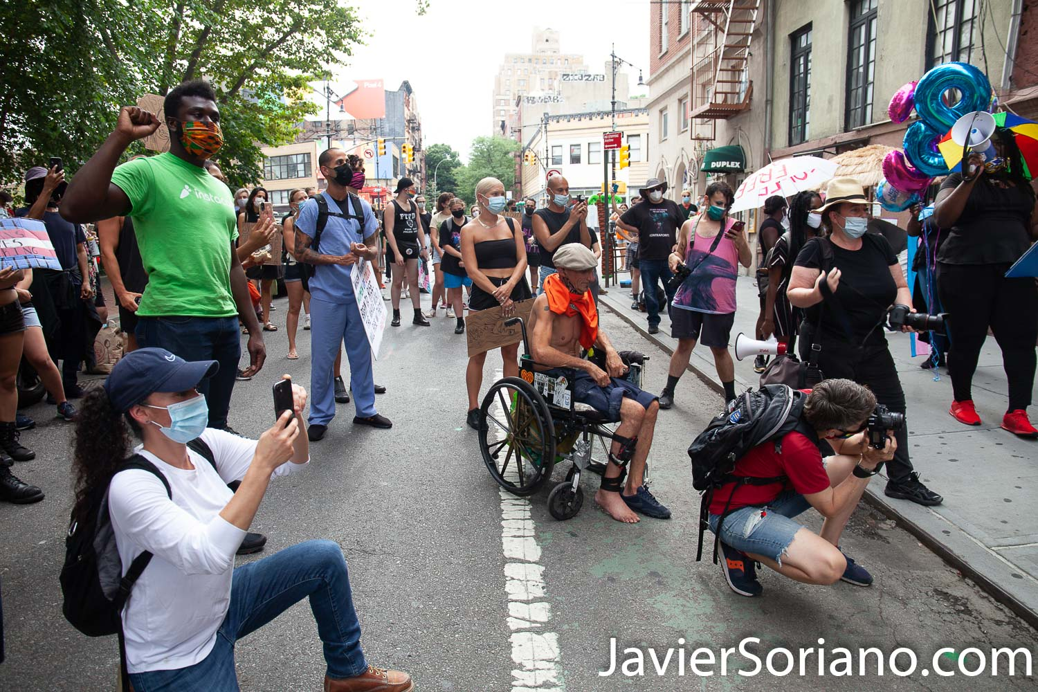 """Thursday, July 30, 2020. Manhattan, New York City - Rally and March: """"Liberation for Black Queer and Trans people.""""  Protesters had a rally in front of The Stonewall Inn. After the rally, they marched to Foley Square Park.  A Trans woman  said sometimes Trans women and Trans men are killed by police and sometimes they are killed by their own community. Activists said all Black Lives Matter.  Joel rivera said, the rally and march was to honor and acknowledge Black Queer and Trans people.  The male protester on the wheelchair harassed a female photographer, a male photographer and me. Three women asked him to stop.  Photo by Javier Soriano/www.JavierSoriano.com"""